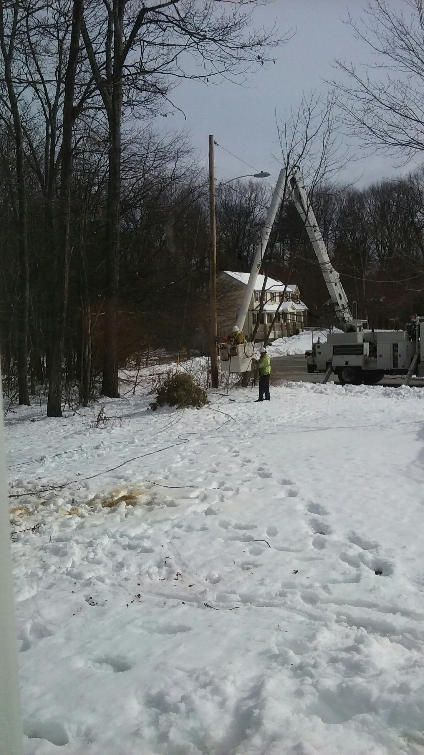 Power crew reconnecting line - Sunday morning.